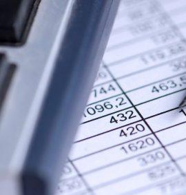 Calculator, pencil and spreadsheet