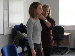 Woman practising Alexander Technique with tutor