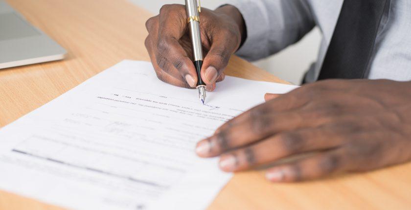man completing a job application form