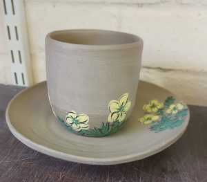 handpainted cup and saucer with yellow flower design