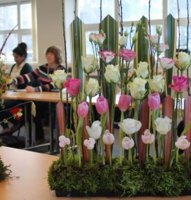 Flower arrangements with pink tulips, cream roses and orange tulips