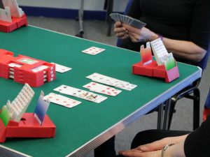 Cards for the game bridge laid on green baize table