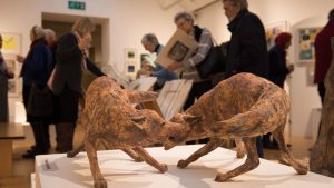 Sculpture of two brown foxes at Art exhibition