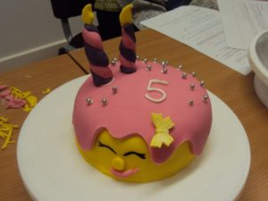 Cake decorated with pink and yellow fondant icing