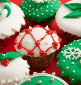 selection of cupcakes decorated in green, red and white for christmas