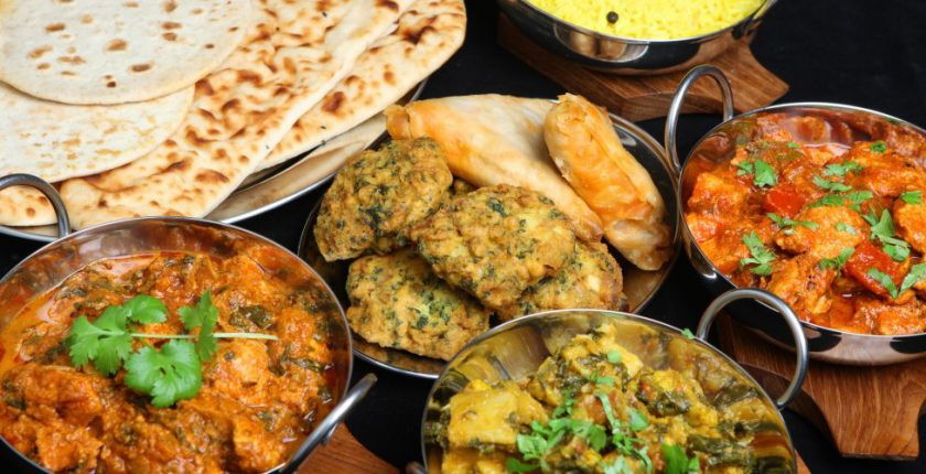 Four indian dishes and naan bread