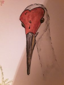 Painting of a crane with a red head