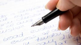 hand writing with a fountain pen