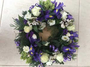 White and purple floral wreath