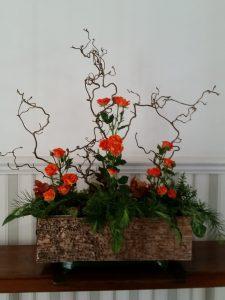 Flower arrangement with orange roses
