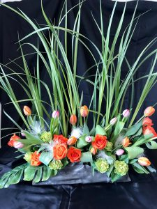 Floral arrangement with orange roses and tulips