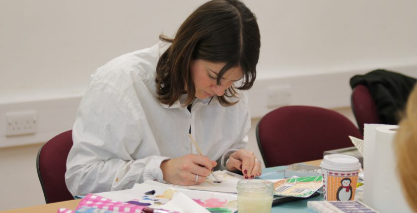 Woman in white shirt painting