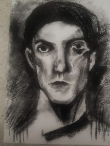 Black and white charcoal drawing of a mans portrait