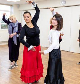 Six women in Flamenco dancing class
