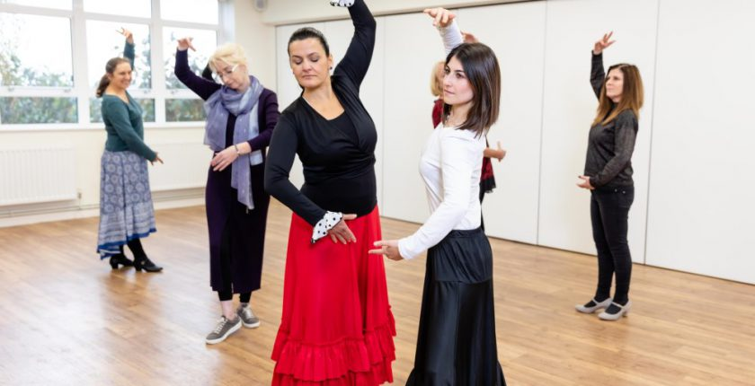 Six women in Flamenco dancing class