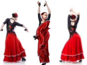 Three flamenco dancers in red dresses