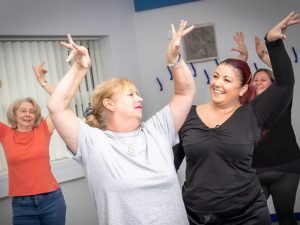 Four women in flamenco fitness class