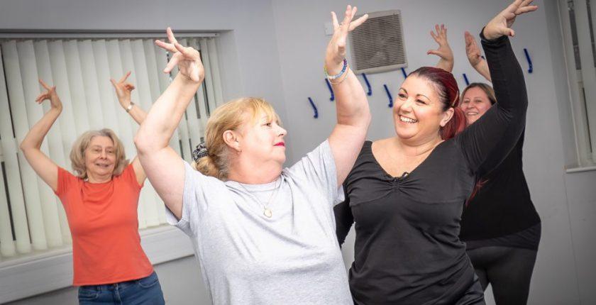 Four women in flamenco fitness class