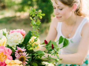 Woman arranging pink and white flowers