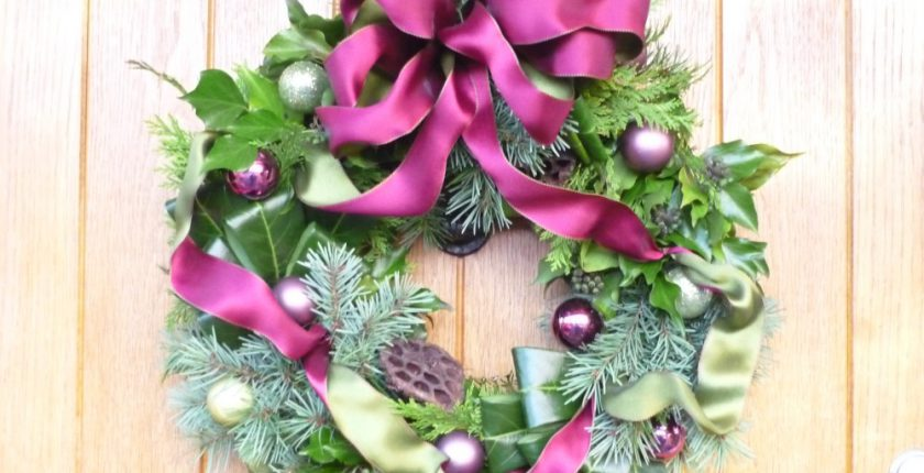 Purple and green christmas wreath with baubles
