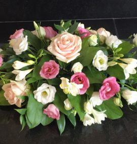 Flower arrangement with pink roses and white fresias