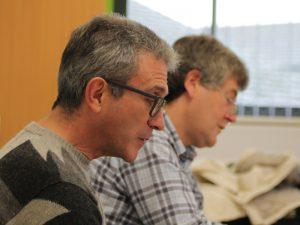 Two men learning German