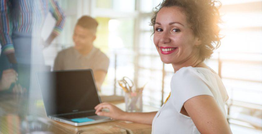 Lady using laptop computer facing the camera