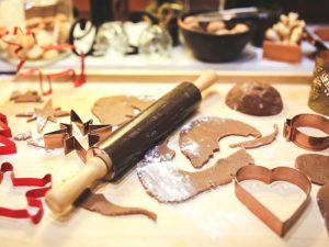 Rolling pin, pastry cutters and gingerbread dough