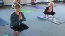Two women practising yoga