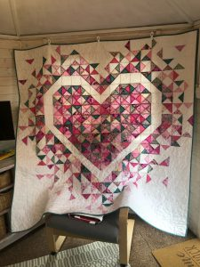 Patchwork quilt with heart design