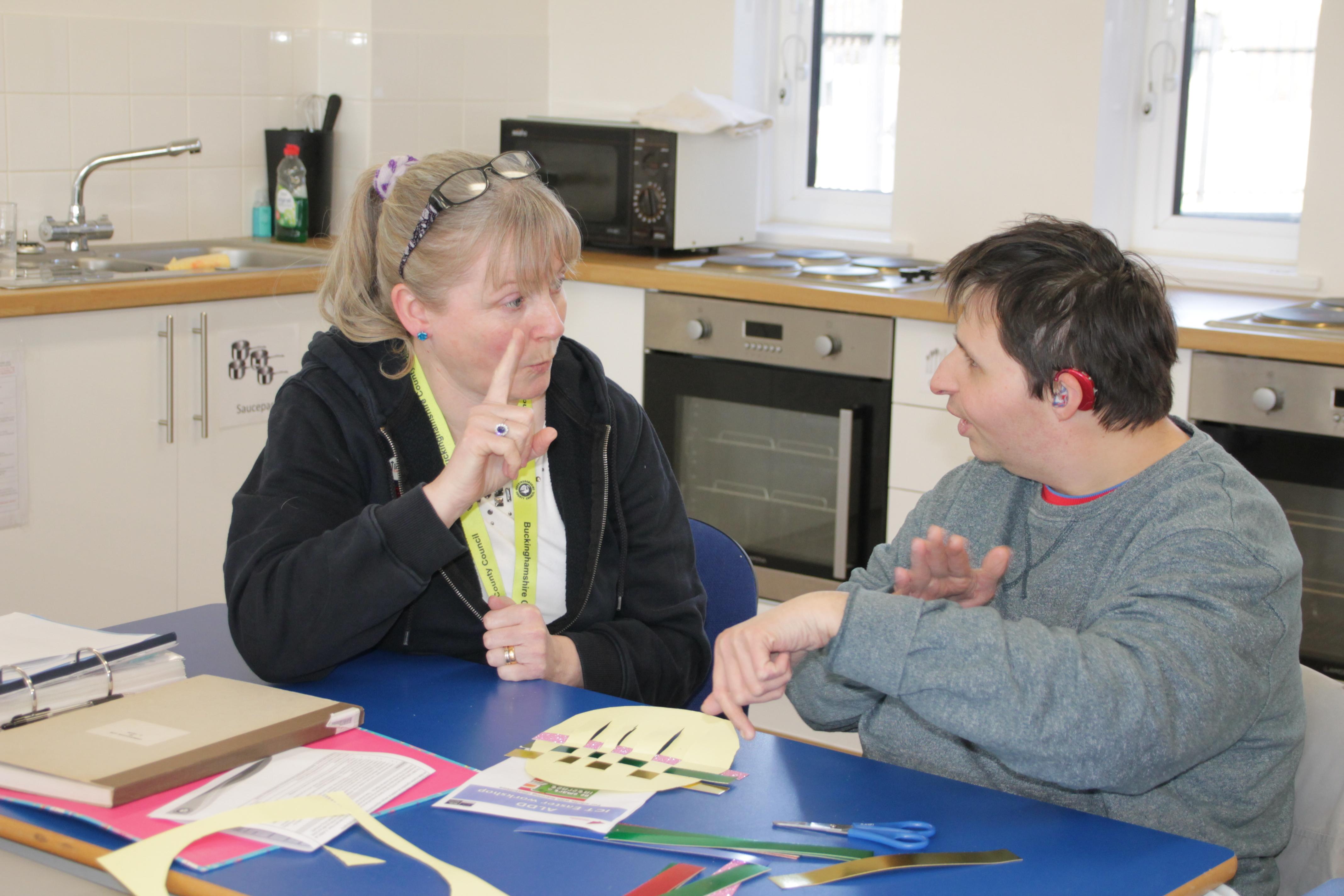 Two people communicating using sign language
