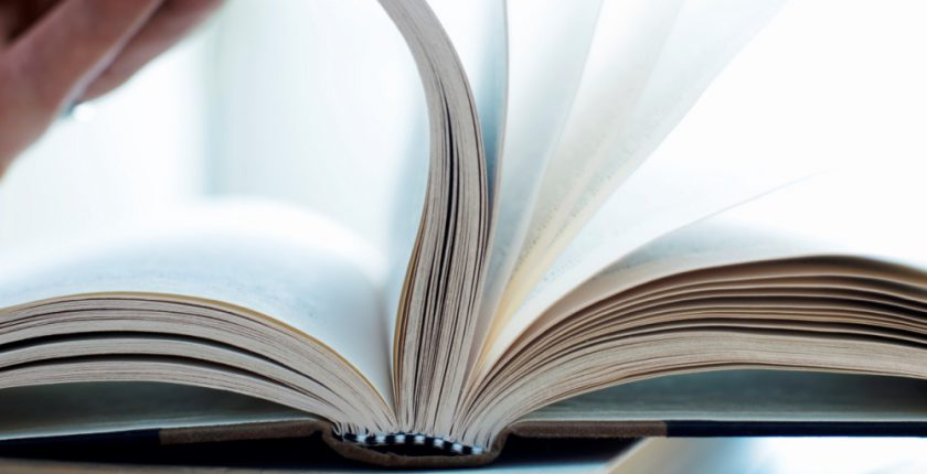 hand flicking through a book