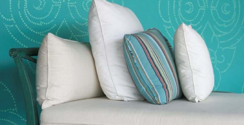 Turquoise and cream cushions on a chaise longue