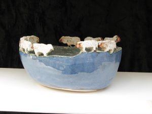 Blue glazed bowl with sheep on the top