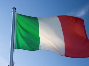 Italian flag against blue sky