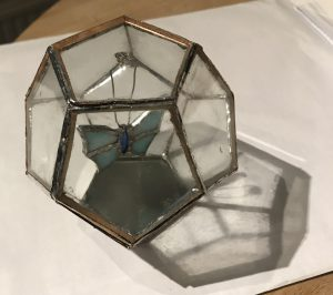 Glass and metal hexagon box with butterfly inside