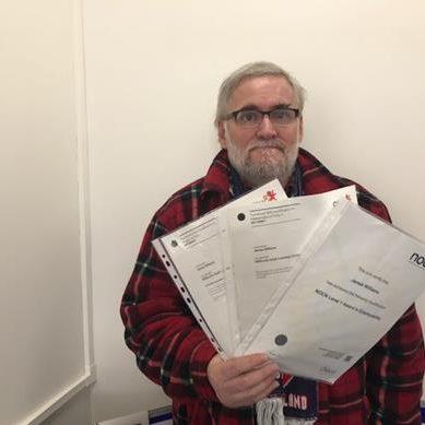 Man holding certificates