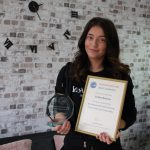 Young woman with award