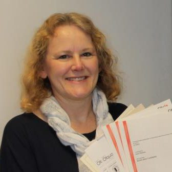 Lady with blond hair and scarf holding certificates