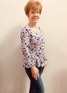 Woman in handmade paisley blouse