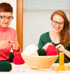 Two women knitting