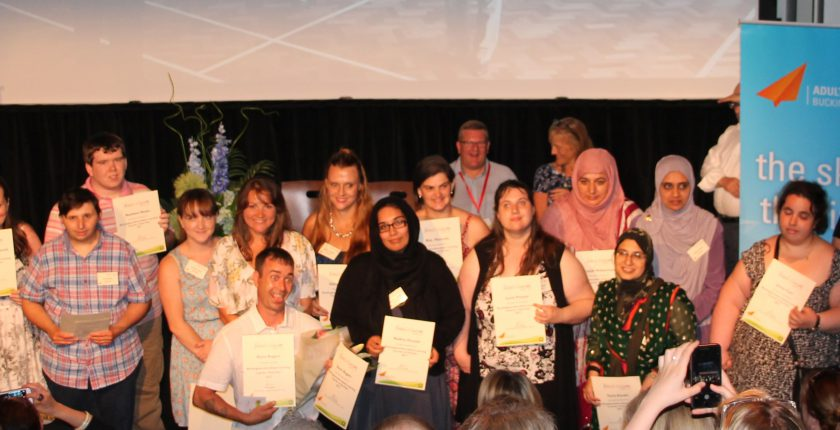 Group of adult learners at awards ceremony