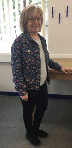 woman in handmade floral jacket