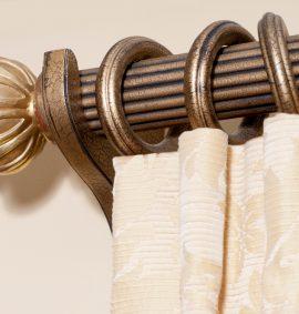 Curtain pole with cream curtains