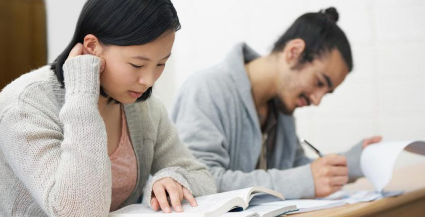 Two adult learners reading