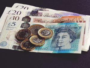 pound coins and notes in sterling