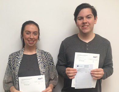 A woman and young man holding GCSE certificates