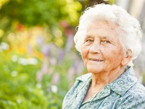 older lady in a garden