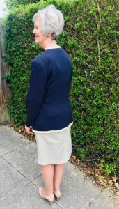 Woman in handmade skirt and jacket - back view