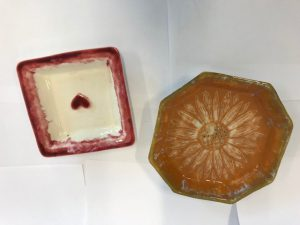 Two handmade decorated ceramic dishes